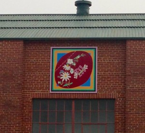 A beautiful quilt panel pops with color on the old Cotton Gin building in McCormick.