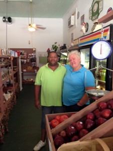 Larry Posley and Cindy Adams show off the fresh fruits and vegetables and various other products at the Produce Patch.