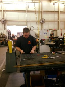 People work hard at Stoll Fireplace, whether they are cutting metal or exacting measurements.